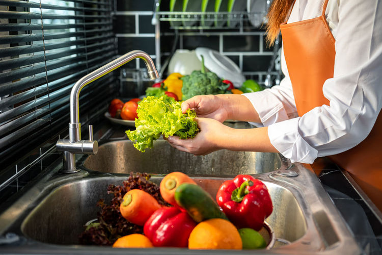 High angle view of fruits and vegetables in kitchen at home