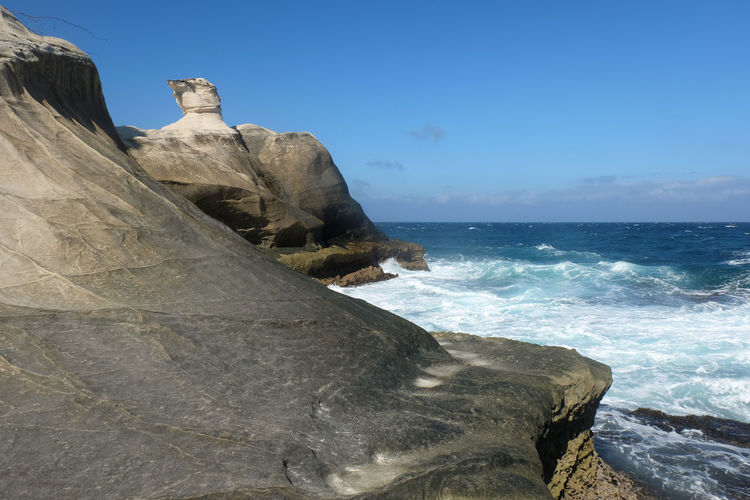 Kapurpurawan rock formation in Ilocos Norte ASIA Ilocos Kapurpurawan Philippines Beach Beauty In Nature Clear Sky Day Horizon Over Water Nature No People Norte Outdoors Rock - Object Rock Formation Scenics Sea Sky Tropical Water Wave