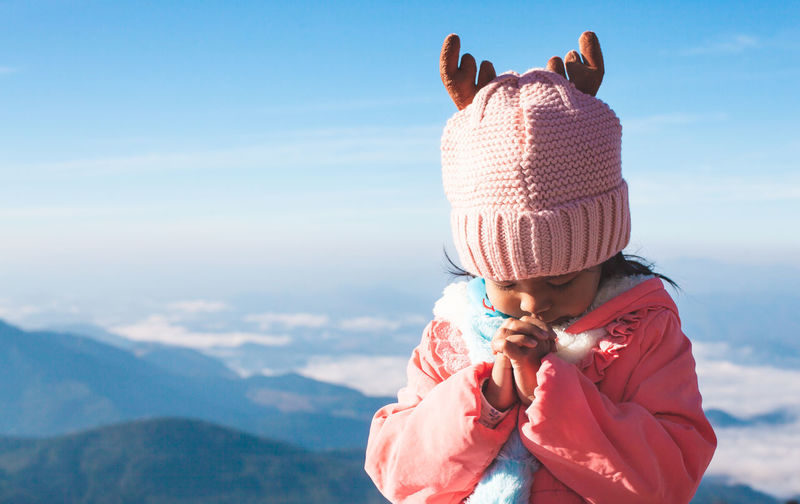 Cute asian child girl wearing sweater and warm hat making folded hands in prayer in beautiful mist and mountain background in winter Child Kid Girl Nature Asian  Beauty In Nature Beautiful Travel Trip Journey Relaxation Vacation Winter Sweater Cold Weather Mountain Belief Catholic Christian Pray Prayer Religion Spiritual Worship Holy