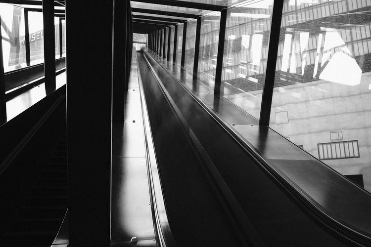 Capturing Motion Indoors  Built Structure Modern Motion Escalator Glass - Material Architecture Building Fujifilm_xseries Xf23mmf2 X-PRO2 Fujifilm Monochrome Photography Monochrome Blackandwhite Streetphotography Street Photography