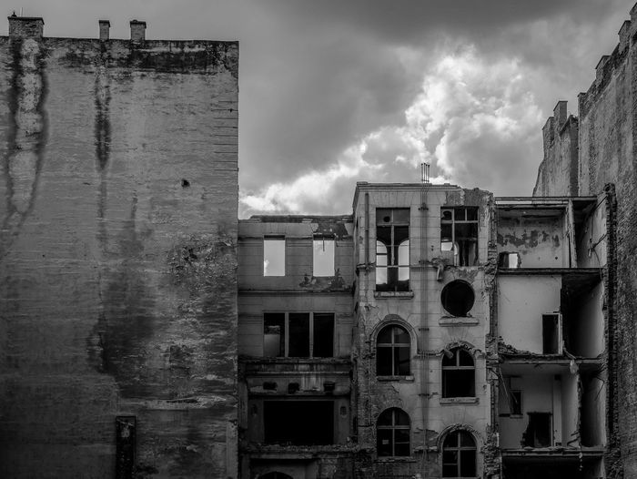Abandoned building against sky in city