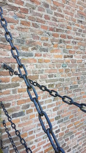 Castle Dungeon Iron Ironwork  Backgrounds Brick Brick Wall Bridge Chains Brown Building Exterior Castle Walls Chains Close-up Day Door Kasteel Doornenburg Medieval Metal No People Outdoors Strong Tension The Way Out Trapped Wall