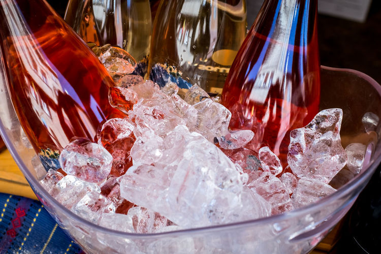 bottles of wine in the ice bowl Bottles Of Wine In The Ice Bowl Food And Drink Cold Temperature Frozen Food No People Refreshment Indoors  Freshness Glass Ice Cube Household Equipment Drinking Glass Close-up Table Frozen Food Sweet Food Container Sweet Ice Ice Cream