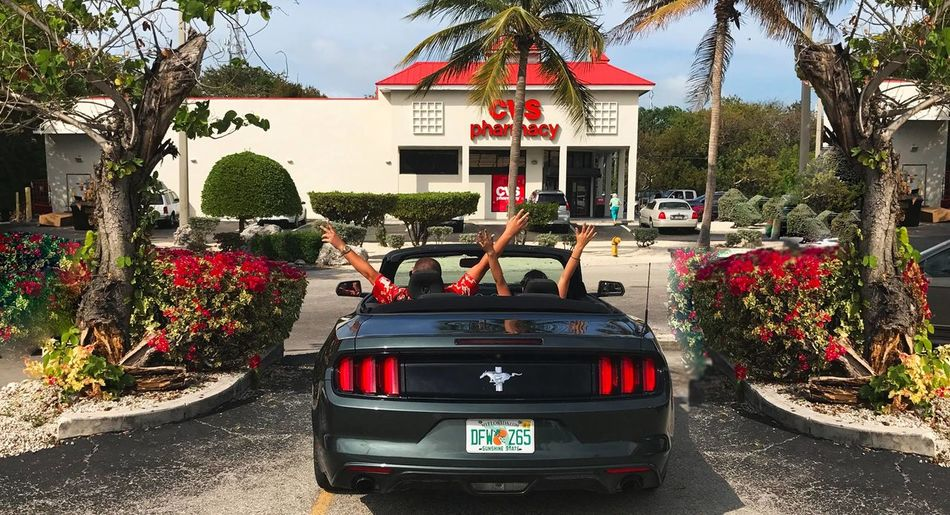 couple in mustang convertible arms up Freedom Mustang Architecture Building Exterior Built Structure Car Communication Convertible Ride Cvs Pharmacy Day Florida Flower Growth Land Vehicle Mode Of Transport Nature No People Outdoors Plant Red Shadow Text Transportation Tree