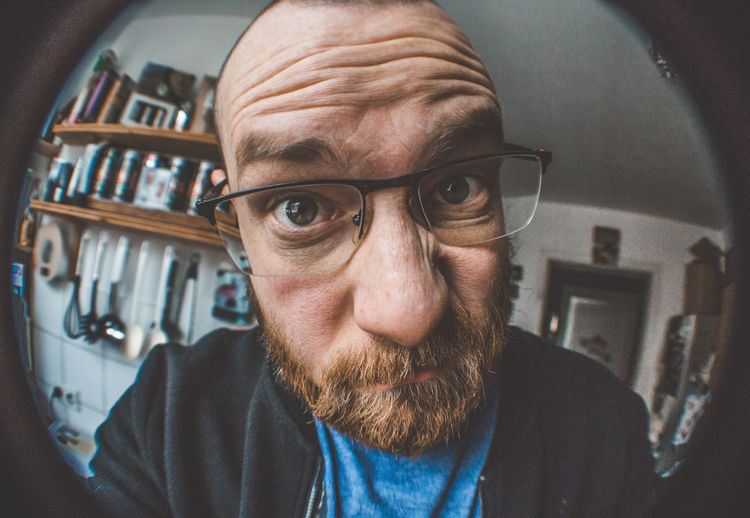 Portrait Front View One Person Glasses Headshot Beard Facial Hair Eyeglasses  Males  Looking At Camera Men Adult Real People Indoors  Close-up Lifestyles Mature Men Mature Adult Human Face Hairstyle Eyebrow Fisheye Watching Grotesque