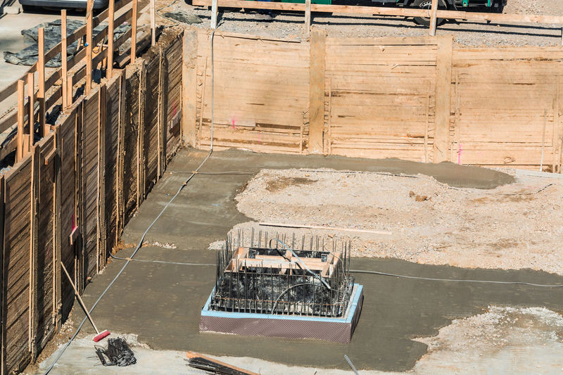 Foundation building of steel and concrete for the construction of an apartment building with underground parking. Base Plate Smart Foundation Rebar Architecture Building Built Structure Concrete Day Formwork Industry Material No People Outdoors Rebar Mats Reinforcing Steel Bars