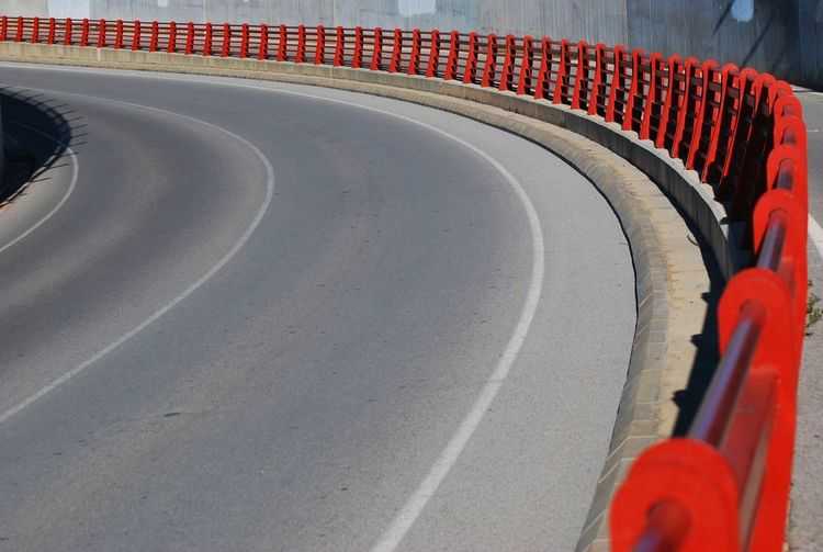 View Of Red Railing By Highway