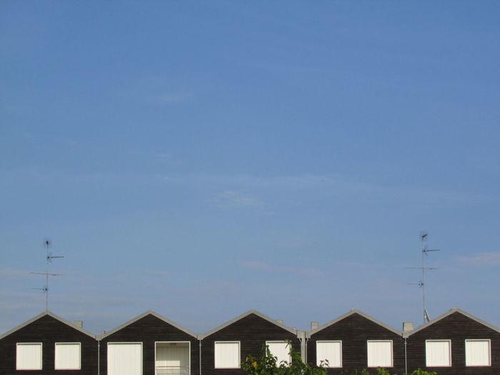 Row houses against clear blue sky