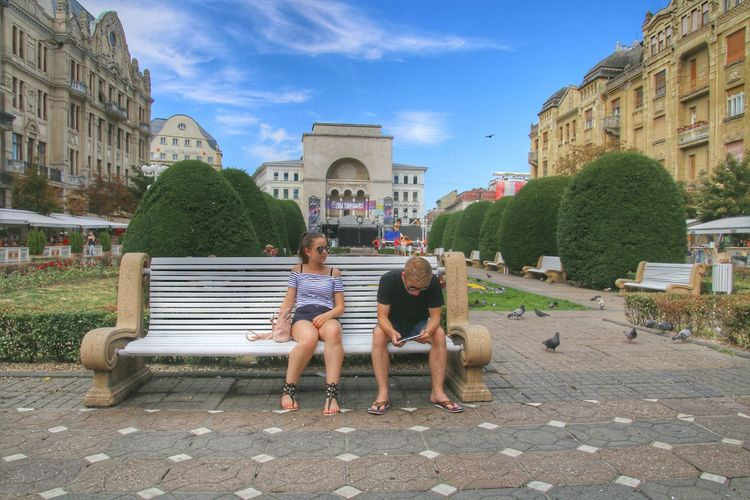 Building Exterior Architecture Dog Two People Sitting Built Structure Sky Togetherness Outdoors Girls Child People Pets Full Length City Friendship Childhood Tree Day Adult Timisoara