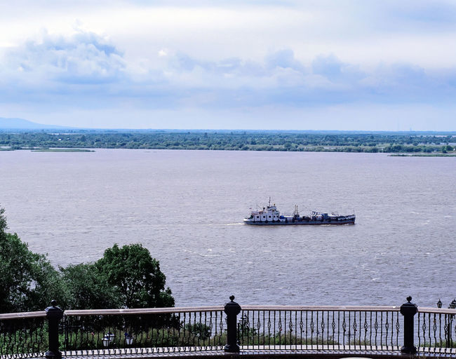 Amur river Cargo Ship Tree Architecture Beauty In Nature Cloud - Sky Day Horizon Looking At View Mode Of Transportation Nature Nautical Vessel Outdoors Railing River River Ship Ship Sky Summer Transportation Travel Water