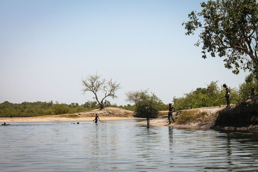 Tree Water Lake Nature Landscape Tranquility Beach Outdoors Beauty In Nature Sky Day Sunnyday🌞 Scenics Sand Clear Sky Flood People Together Makasutu Gambia, Africa Children Enjoying Connected By Travel