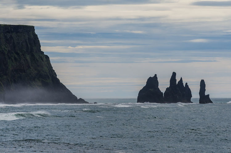 Reynisdrangar Beauty In Nature Cloud - Sky Day Horizon Over Water Nature No People Outdoors Reynisdrangar Rock - Object Rock Formation Scenics Sea Sky Tranquil Scene Tranquility Trolls And Elves Vík í Mýrdal Water