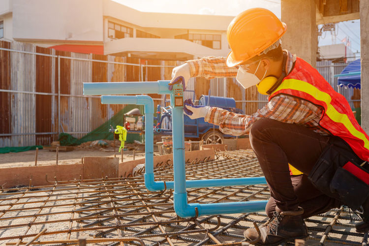 Side view of man working at construction site