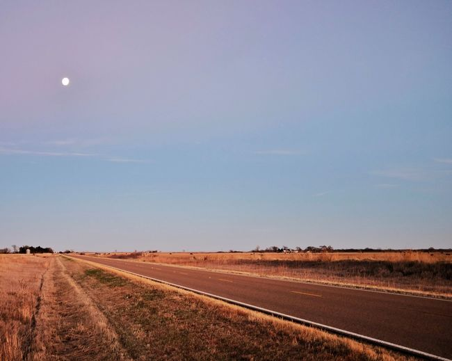 """You ask a lot of the moon When you ask me to forget... - """"Moonrise"""" Saline County Nebraska November 2015 Atmosphere Check This Out Composition Copy Space Diagonals Dusk EyeEm Best Shots Full Moon Highway Horizon Over Land Landscape Moonrise Nebraska Non-urban Scene On The Road Outdoors Photography Remote Scenics Silencevsnoise Sky Solitude Tranquil Scene Tranquility What Does Music Look Like To You?"""