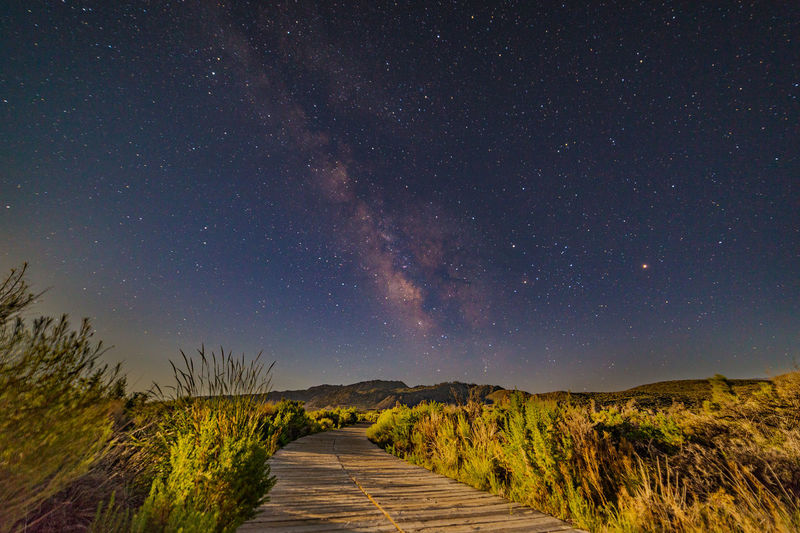 Boardwalk to the Milky Way As the moon rose higher, the Milky Way slowly faded into the night sky. The moonlit boardwalk was the only way to reach the Milky Way. Astronomy Astrophotography Beauty In Nature Boardwalk Bushes Diminishing Perspective Galaxy Grass Infinity Landscape Landscape Photography Mono Lake Moonlight Nature Night Night Photography No People Non-urban Scene Outdoors Remote Sky South Tufa The Milky Way Tranquility Vanishing Point