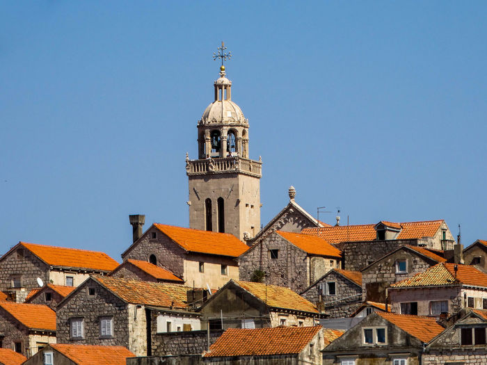 Korčula Architecture Bell Tower Blue Building Exterior Built Structure City Clear Sky Clock Tower Day History Korcula Island Low Angle View No People Outdoors Place Of Worship Religion Sky Spirituality Tower Town Travel Destinations