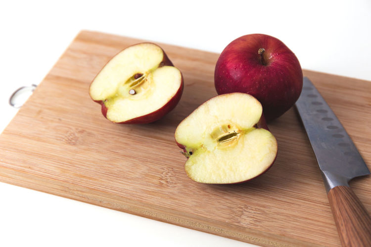 Close-up of apple on cutting board