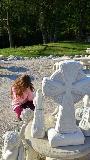 Praying Praying Child Cross Enjoyment Garden Decor Prayertime Prayer Long Hair Casual Clothing Full Length Sweet Moments Innocence Of Youth Park - Man Made Space Garden Architecture Long Hair Casual Clothing Kneeling Girl Sw Kneeling Trees Childhooddays TakeoverContrast