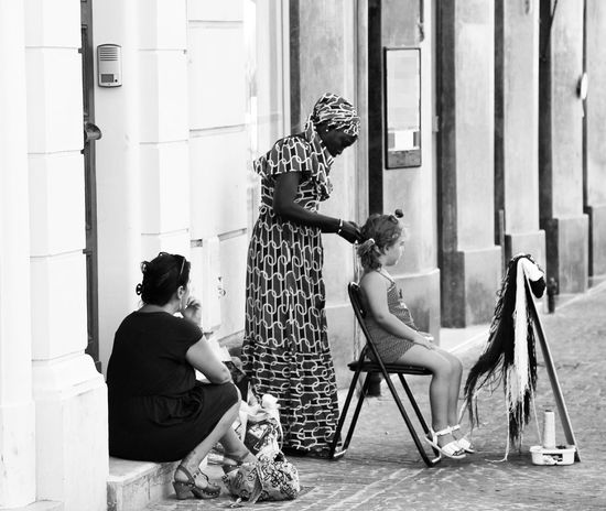 -WOMEN- a woman braids the hair of a girl while the grandmother is watching Generations International Women's Day Women Of Europe Women Of EyeEm Women At Work Womensday Streetphoto Capture The Moment Blackandwhitephotography Captured Moment Blackandwhite Noir Et Blanc Schwarz & Weiß Blanc Et Noir Black & White Bianco E Nero Black And White Photography Black And White Collection  Bnw_of_our_world Bnw_collection Bnw Photography Black And White Blancoynegro Schwarz Weiß Bnw_worldwide