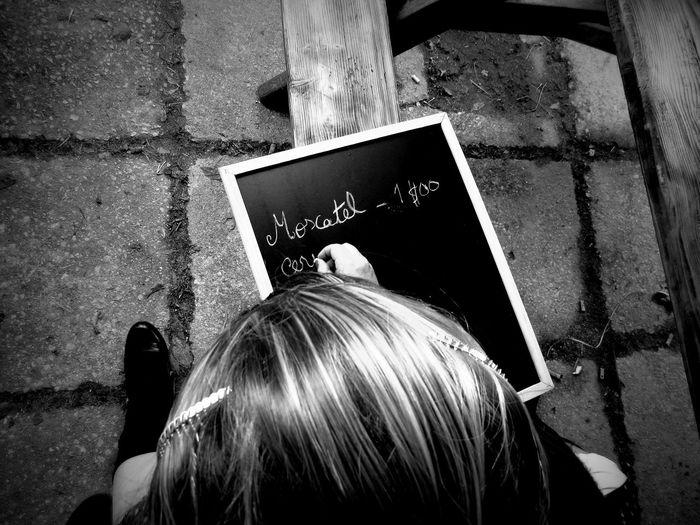 High angle view of writing on slate bench