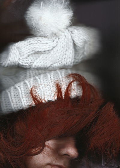 Close-Up Of Young Woman With Redhead Wearing Knit Hat