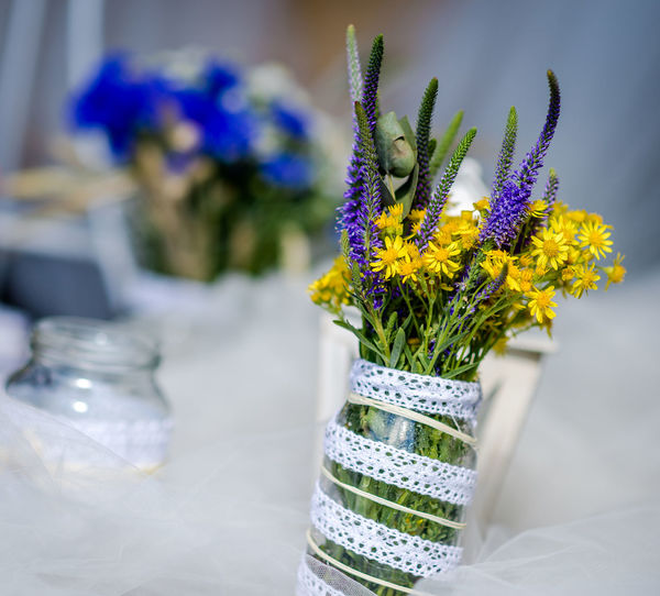 Close-up of flowers in mason jar on table