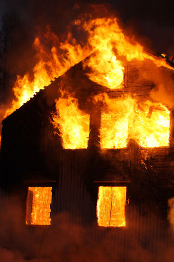 An old Wooden house burning
