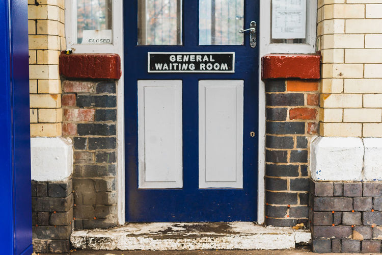 Waiting room door at a train station just outside of Manchester, UK. Architecture Blue Door Doors United Kingdom Architecture Blue Brick Wall Building Exterior Built Structure Closed Places Day Door Doorway Doorways No People Old Buildings Outdoors Text Traditional Architecture Train Station Train Station Platform Waiting Room Window