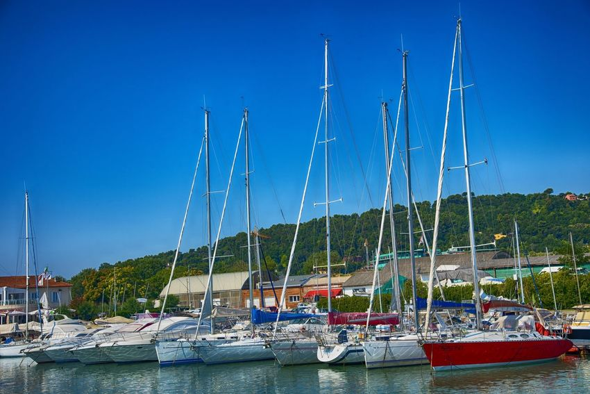Anchored Blue Clear Sky Day Harbor Marina Marine Mast Mode Of Transportation Moored Nature Nautical Vessel No People Outdoors Pole Port Sailboat Sea Sky Transportation Travelling Photography Water Waterfront Yacht