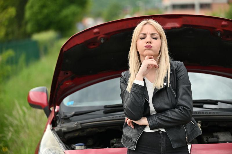 Full length of woman in car