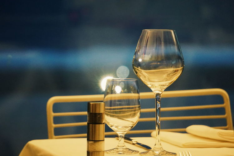 glasses at a restaurant table Glass Glasses Empty Glass Wine Glass Restaurant Table Wineglass Wine Drinking Glass Alcohol White Wine Drink Food And Drink Cocktail Defocused Close-up Winetasting No People