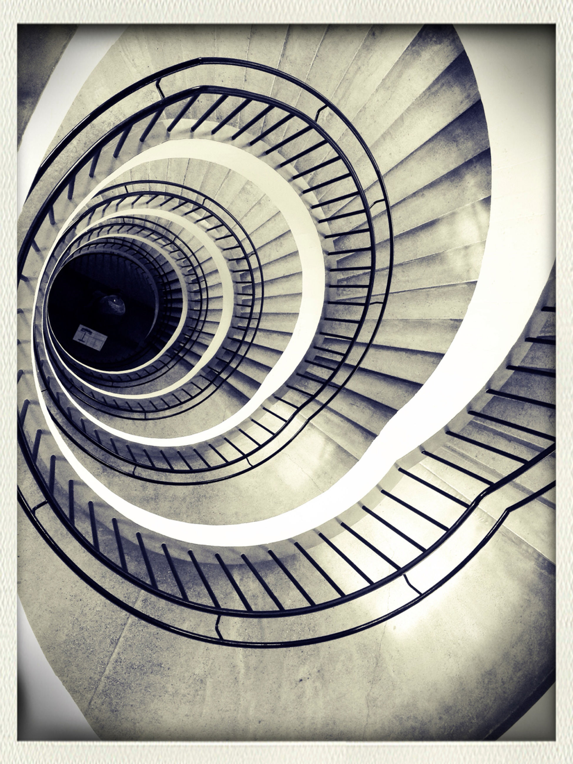 transfer print, spiral, steps and staircases, architecture, built structure, staircase, spiral staircase, auto post production filter, steps, indoors, railing, pattern, low angle view, building exterior, modern, building, repetition, design, circle, stairs