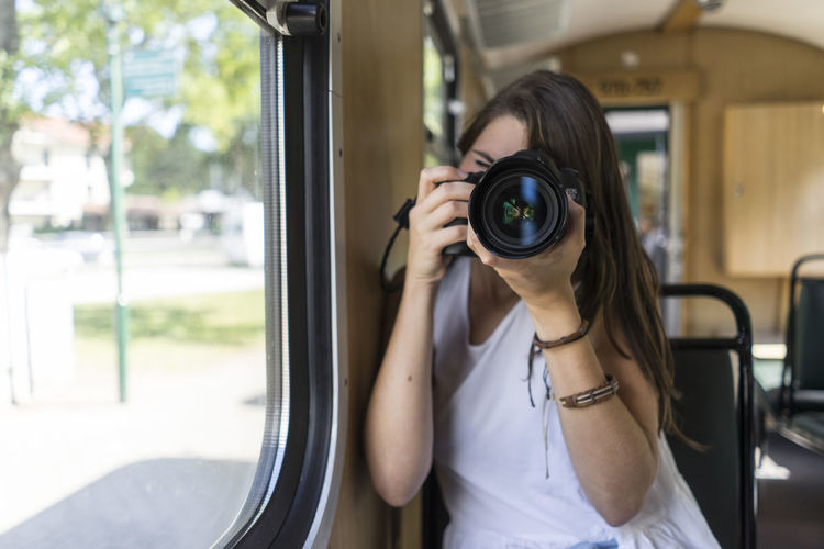 Camera Taking Pictures Camera - Photographic Equipment Day Digital Single-lens Reflex Camera Girl With Camera One Person Outdoors People Photographing Picture Real People Technology Transportation Young Adult