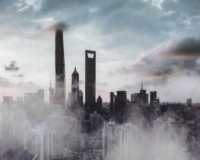 Building Exterior Architecture Sky Built Structure Cloud - Sky City Building Environmental Issues Air Pollution Pollution Landscape Outdoors Nature No People Tall - High Office Building Exterior Urban Skyline Cityscape Skyscraper Day