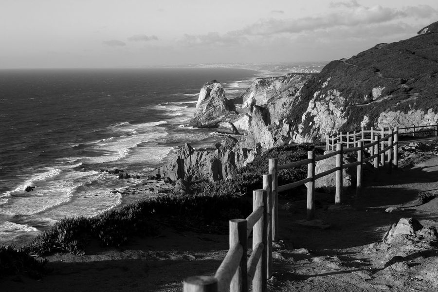 Seaside Cliffside Black & White Rocks Black And White EyeEm Blackandwhite Blackandwhite Photography Bnw Eye4photography  EyeEm Best Shots EyeEm Nature Lover EyeEmBestPics Nature Naturelovers Sky And Clouds Waves, Ocean, Nature Wooden Fence Light And Shadow EyeEm Gallery Taking Photos at Cabo Da Roca Portugal The KIOMI Collection Showcase April