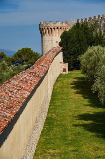 Fortress of the Lion, Castiglione del Lago, Umbria Italy Historic Umbria Medieval Architecture No People Architecture Castiglione Del Lago Blue Sky Trees Fortress Wall Fortress Fort Castle Medieval Historical Building History Outdoors Architectural Lines Built Structure Blue Sky And Clouds Tiles