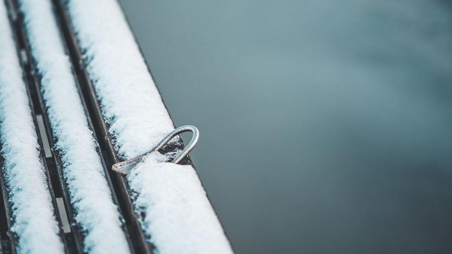 Close-up of snow on metal railing
