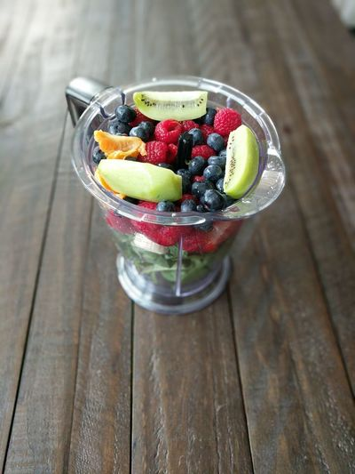 Close-Up Of Various Fruits In Mixing Bowl On Table
