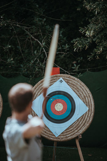 Man aiming for archery target Man Archer Archery Archery Bows Archery Competition Archery Lesson Archery Target Boys Holding Leisure Activity Lifestyles Men One Person Real People Rear View