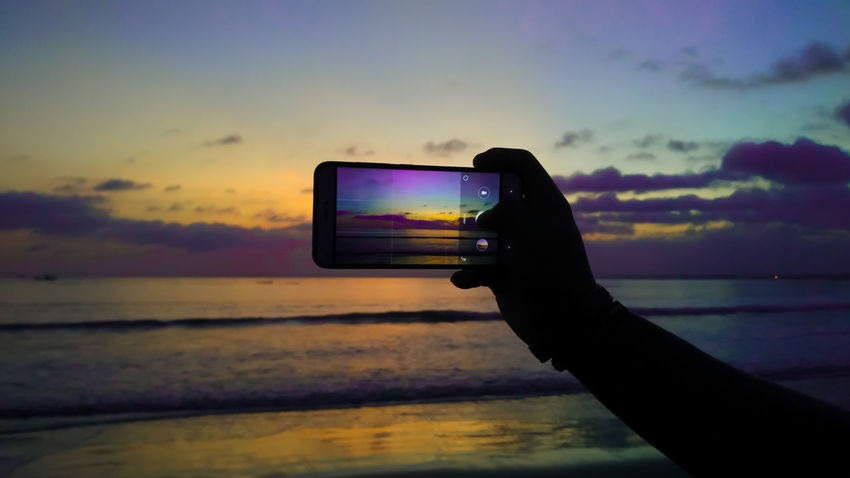 Take a moment Smart Phone Human Hand Photography Themes Mobile Phone Technology Sunset Communication Multi Colored Cloud - Sky Sky Selfie Water Device Screen Photographing Photo Messaging Silhouette Humaninterest Silhouette Beach Beachphotography Sky Sunset Sunset Silhouettes Sunset Sunrise