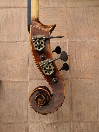 Close-Up Of Violin Against Wall