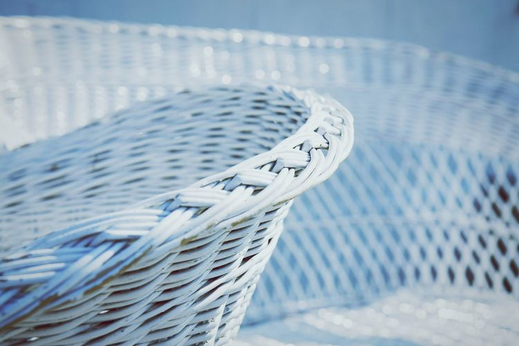 Cropped image of white rattan chair
