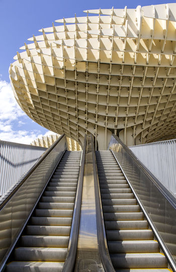 Low angle view of staircase against sky