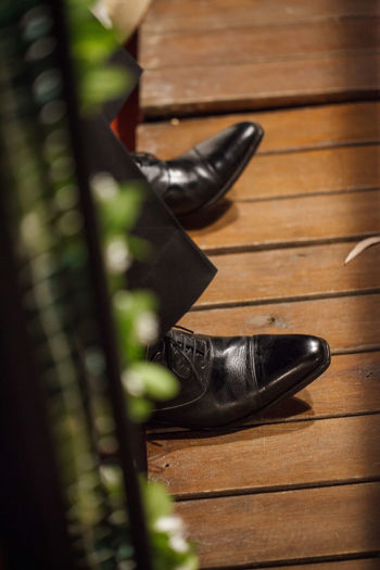 High Angle View Of Shoes On Wooden Floor