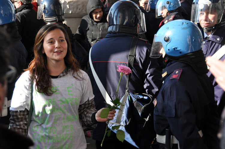 no violence: a girl gives a rose to a cop Cop Girl Helmet People Piazza Unità Police Force Rose - Flower Street Photography Student Protest Trieste The Photojournalist - 2018 EyeEm Awards