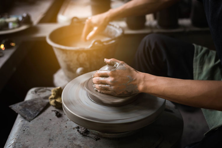 Midsection Of Potter Making Craft Product