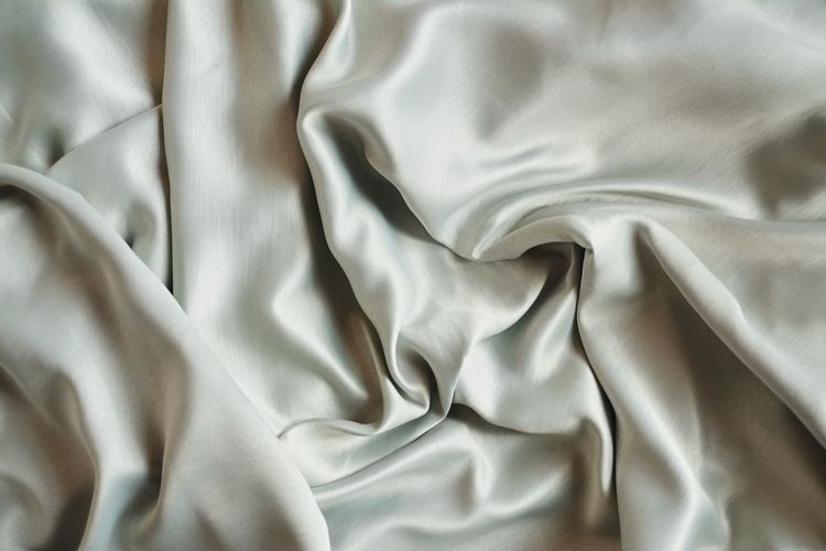 Textile Full Frame Crumpled Pattern Backgrounds No People Textured  Rippled Indoors  Wrinkled Material Bed Sheet Linen Wave Pattern Softness Abstract Shiny White Color Close-up Silk Luxury Silver Colored