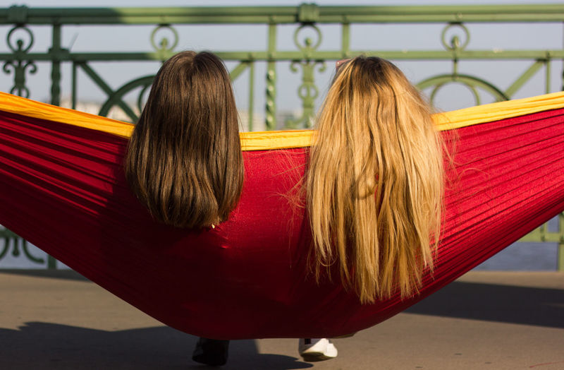 Rear view of women sitting outdoors