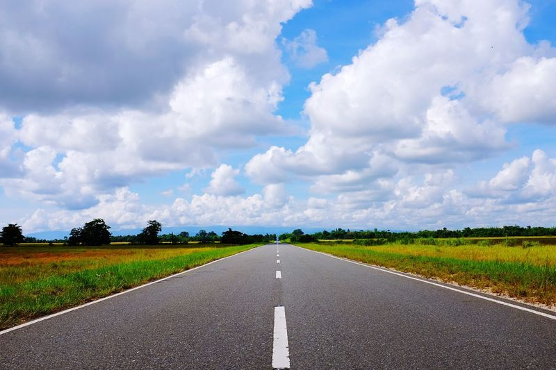 The Road Cloud - Sky The Way Forward Road Landscape Sky Grass Nature Scenics No People Field Tranquility Rural Scene Transportation Green Color Outdoors Beauty In Nature Day Tranquil Scene Growth Asphalt