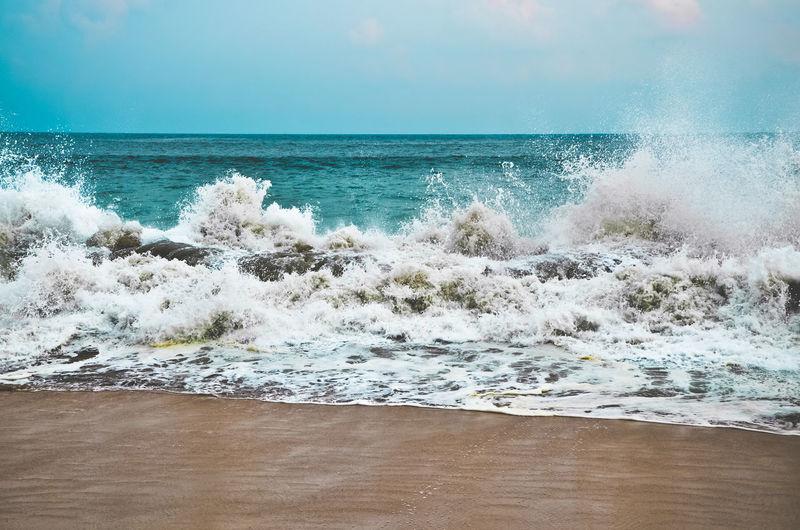 Sea Waves Splashing On Shore At Beach